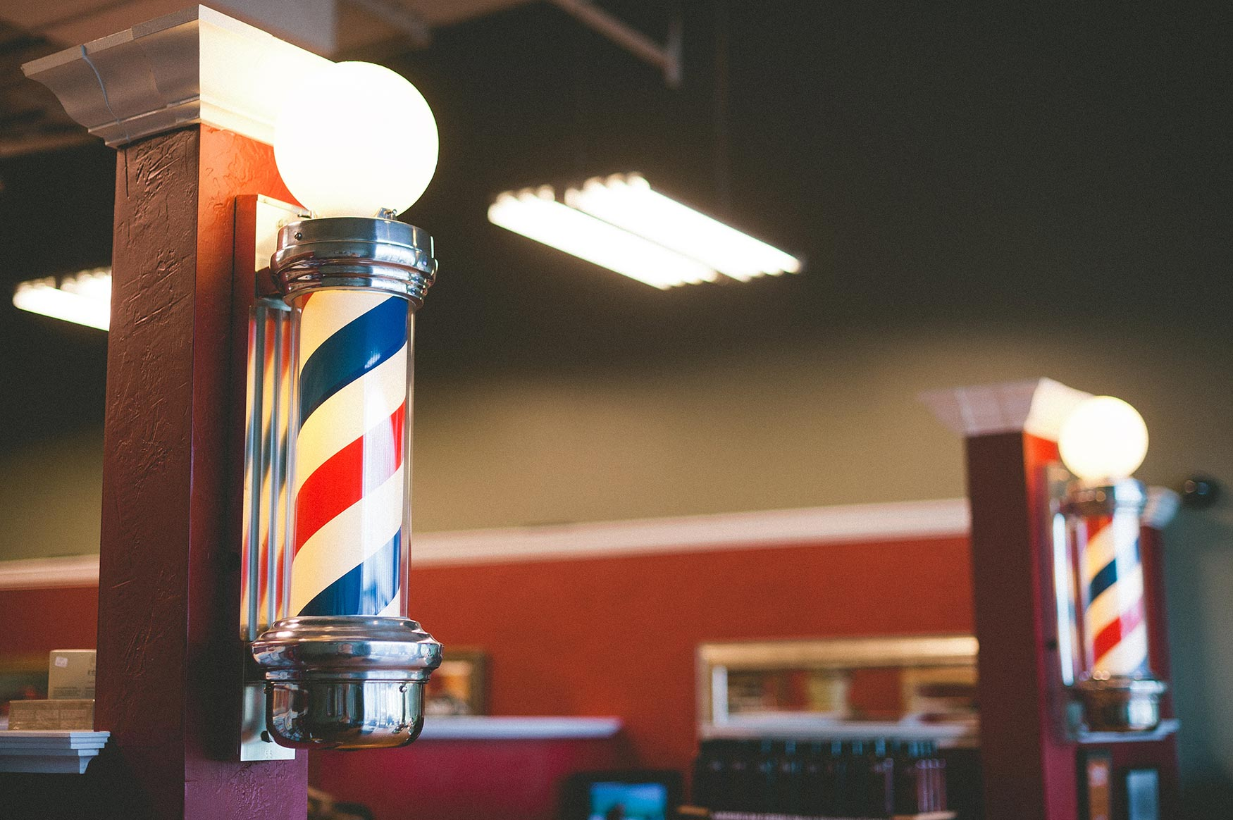 The Man Salon Barber Shop Poles